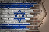 foto of israeli flag  - Dark brick wall texture with plaster  - JPG