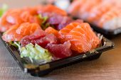 pic of trays  - Tray of tuna and salmon sashimi Japanese.