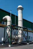 picture of gas-pipes  - Pipe of factory gas and oil industry against the blue sky - JPG