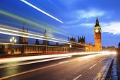 stock photo of london night  - Big Ben and London at night with the lights of the cars passing by after rain the most prominent symbols of both London and England - JPG