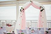 stock photo of wedding arch  - wedding isle and arch with weddings chairs and wedding flower decoration - JPG