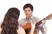pic of serenade  - handsome young man with guitar serenading young girl isolated on white - JPG