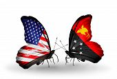 pic of papua new guinea  - Two butterflies with flags on wings as symbol of relations USA and Papua New Guinea - JPG