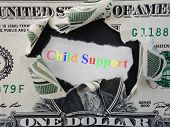 picture of rip  - Hole ripped in a dollar bill with colorful Child Support text - JPG