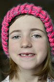 pic of missing teeth  - Little girl smiling portrait missing front tooth with winter hat - JPG