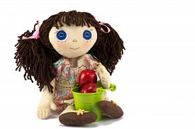 foto of rag-doll  - Rag doll with bucket filled by apples on a white background - JPG