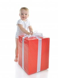 foto of new years baby  - Infant child baby toddler kid with big red present gift for birthday or new year celebration isolated on a white background Christmas new year concept - JPG