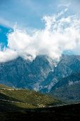 stock photo of albania  - Beautiful rocky mountains with clouds in Albania - JPG