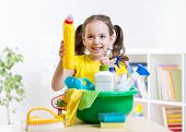 stock photo of cleanse  - Cute child little girl cleanses a floor in nursery - JPG