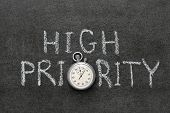 image of priorities  - high priority phrase handwritten on chalkboard with vintage precise stopwatch used instead of O - JPG
