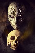 stock photo of post-apocalypse  - Mysterious man in iron mask holding skull - JPG