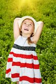stock photo of charming  - Charming little girl on a meadow in summer day - JPG