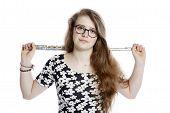 image of flute  - teenage girl with glasses holds flute in studio against white background - JPG