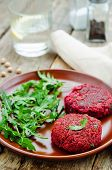 picture of quinoa  - chickpeas quinoa and beet burgers with arugula on a dark wood background - JPG