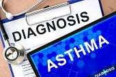 stock photo of asthma  - Form with word diagnosis and tablet with asthma - JPG