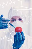 foto of medical injection  - Science and medical graphic against researcher in protective suit injecting tomato at lab - JPG