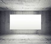 stock photo of illuminated  - Abstract gray interior of empty room with concrete walls and illuminated wide white screen - JPG