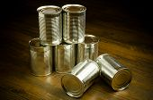 stock photo of cans  - Aluminum cans on wooden background (caned, aluminum, recycle)