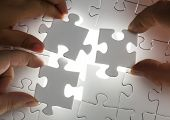 image of joining hands  - Hands completing a puzzle Jigsaw and puzzles concepts - JPG