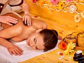 stock photo of stone-therapy  - Happy woman getting stone therapy massage in gerbera spa - JPG