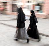 image of nun  - Two nuns walking in motion blur - JPG