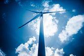 stock photo of generator  - wind generators aganist the blue sky - JPG
