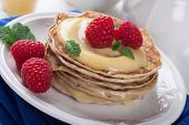 picture of curd  - Delicious pancakes with homemade lime curd and fresh raspberries - JPG