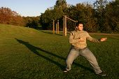 stock photo of shotokan  - shotokan karate training in the park in the afternoon - JPG