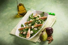 stock photo of mixed nut  - mixed salad with arugula fig cheese and nuts - JPG