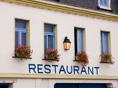 Restaurant In French Town With Restaurant Written On Wall poster