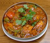 picture of ghee  - home made indian chicken curry also known as rogan josh with tomatoes and bell green peppers typicaql of northern cooking - JPG