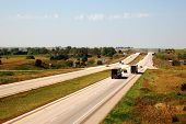 image of 18 wheeler  - interstate 80 unfolds as far as the eye can see on the plains of iowa near adair as cars and trucks journey east 