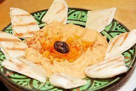 image of humus  - Humus with bread pita in moroccan dish - JPG