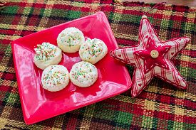 stock photo of shortbread  - Christmas shortbreads and a seasonal decorative star - JPG