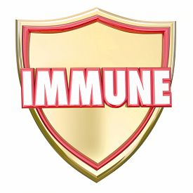 image of shield  - Immune word in red 3d letters on a gold shield to illustrate immunity and protection from risk of diseases - JPG