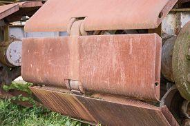 picture of backhoe  - Rusty wheels of big backhoe in nature - JPG