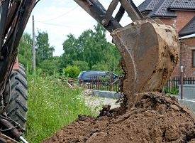 foto of excavator  - working with excavator at road construction site - JPG