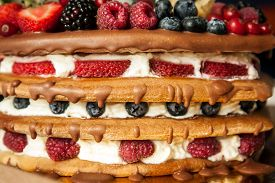 picture of torte  - Close up homemade  torte with berries between layers and on the  top  - JPG