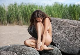 stock photo of nu  - Beautiful young nude woman on nature background - JPG