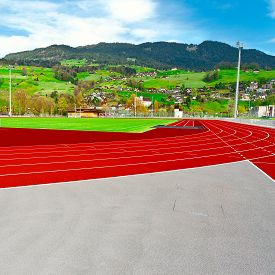 stock photo of track home  - Running Tracks on the Background of Alps in Switzerland - JPG
