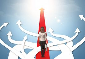 pic of confusing  - Concept of confused businesswoman with different direction arrows - JPG
