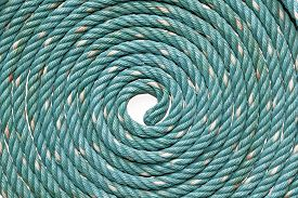 foto of nylons  - Circle Roll texture of old green nylon rope - JPG