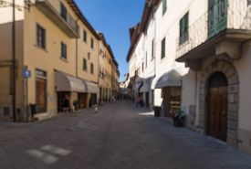 pic of streetwalkers  - Out of focus shot of a small town street scene in Europe - JPG