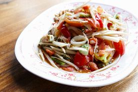 stock photo of cuttlefish  - spicy papaya salad with shrimp cuttlefish and sea mussel  - JPG