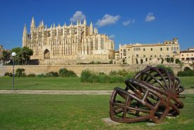 picture of metal sculpture  - Modern abstract metallic sculpture in the foreground of the Palma de Mallorca gothic cathedral - JPG