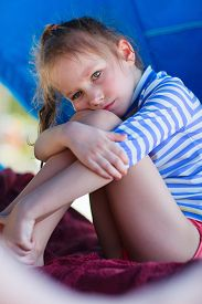 picture of cabana  - Little girl at luxury resort relaxing at beach cabana - JPG