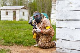 picture of paintball  - Paintball player with paint gun in summer - JPG