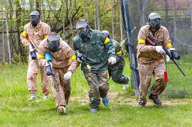 picture of paintball  - Group of sportsmen on start of paintball mission - JPG