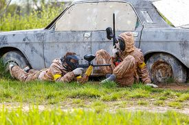 picture of paintball  - Two friends defend old car in paintball mission - JPG