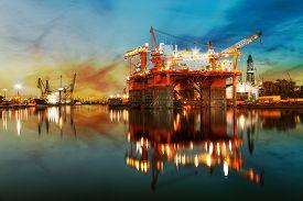 stock photo of shipyard  - Ship under construction in shipyard at sunrise - JPG